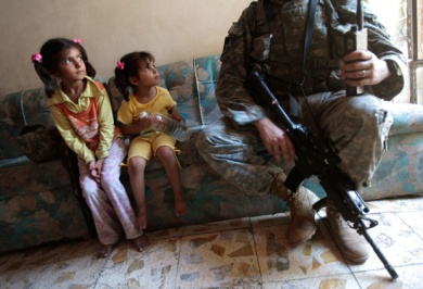 Iraqi girls watch Staff Sgt Nick Gibson on 21 June 2007
